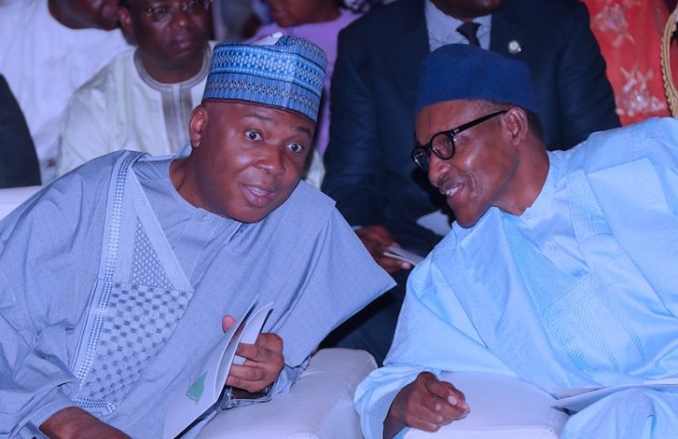 PRESIDENT BUHARI ATTENDS DEMOCRACY DAY LECTURE 2A. President Muhammadu Buhari confers with The President of the Senate, Dr Abubakar Bukola Saraki during the Democracy Day Lecture held at the International Conference Centre in Abuja. PHOTO; SUNDAY AGHAEZE. MAY 28 2018.